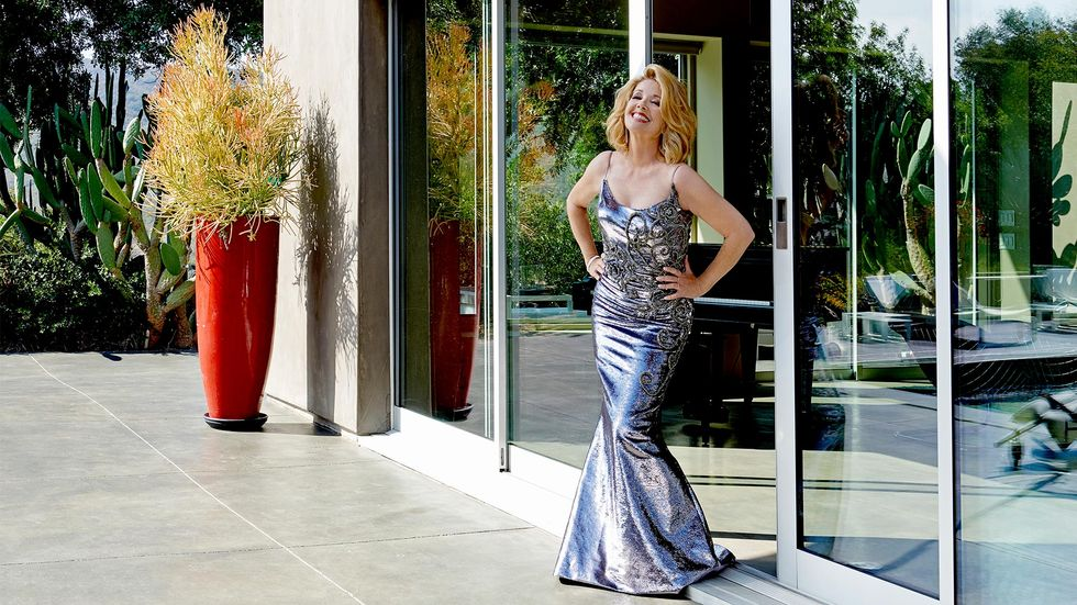 Melody Thomas Scott of The Young and the Restless in a metallic pewter evening gown