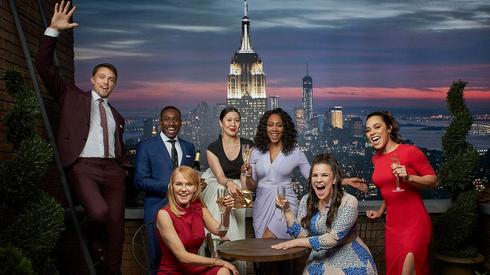 The Cast of All Rise in front of the Manhattan skyline