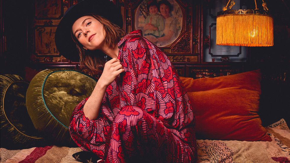Rose Leslie dress in red with cowboy hat