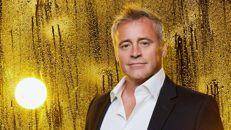 Matt LeBlanc against a rainy window