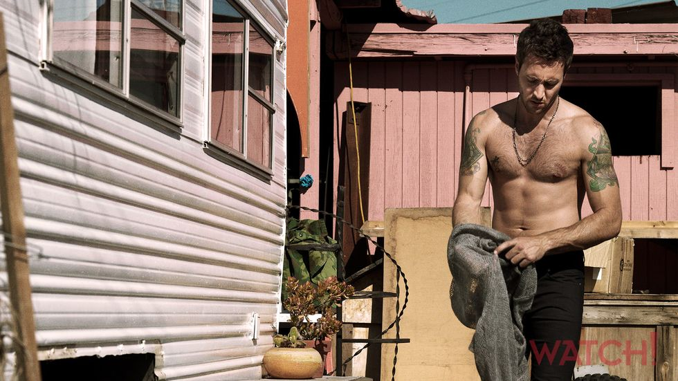 Alex OLoughlin of Hawaii Five 0 shirtless next to a trailer