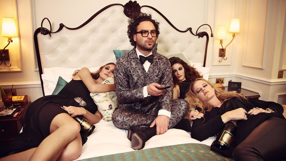 Johnny Galecki snuggles up with ladies watching a movie
