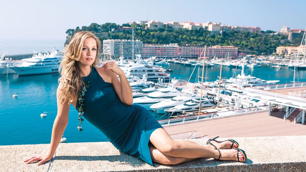 AJ Cook relaxing by the marina