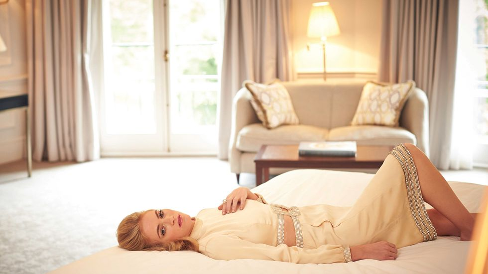 Emily Wickersham snuggles up on bed