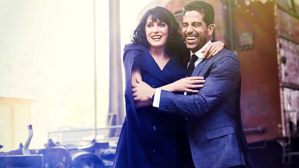 woman and man hug on a train