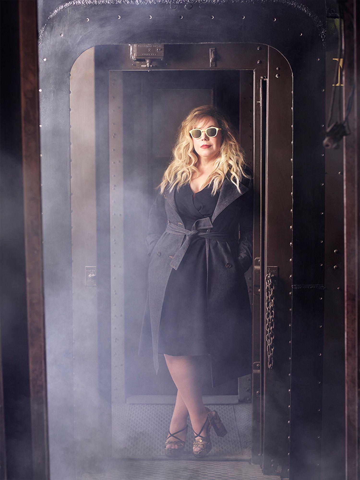 Kirsten Vangsness woman in trench coat