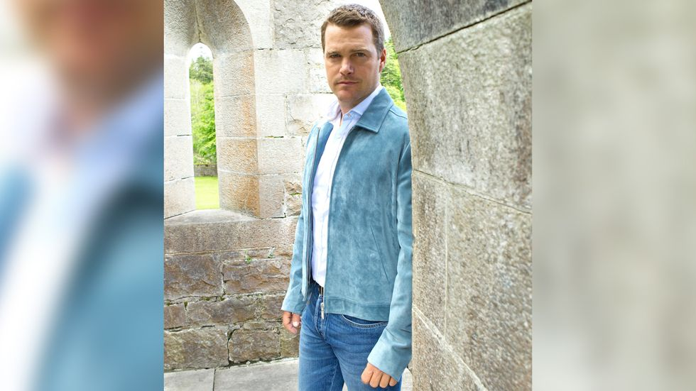 Chris ODonnell in blue jacket and denim pants
