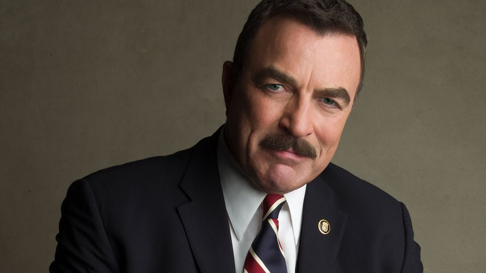 Tom Selleck in black suit and tie