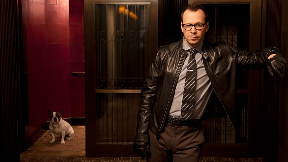 Donnie Wahlberg in black leather jacket with dog