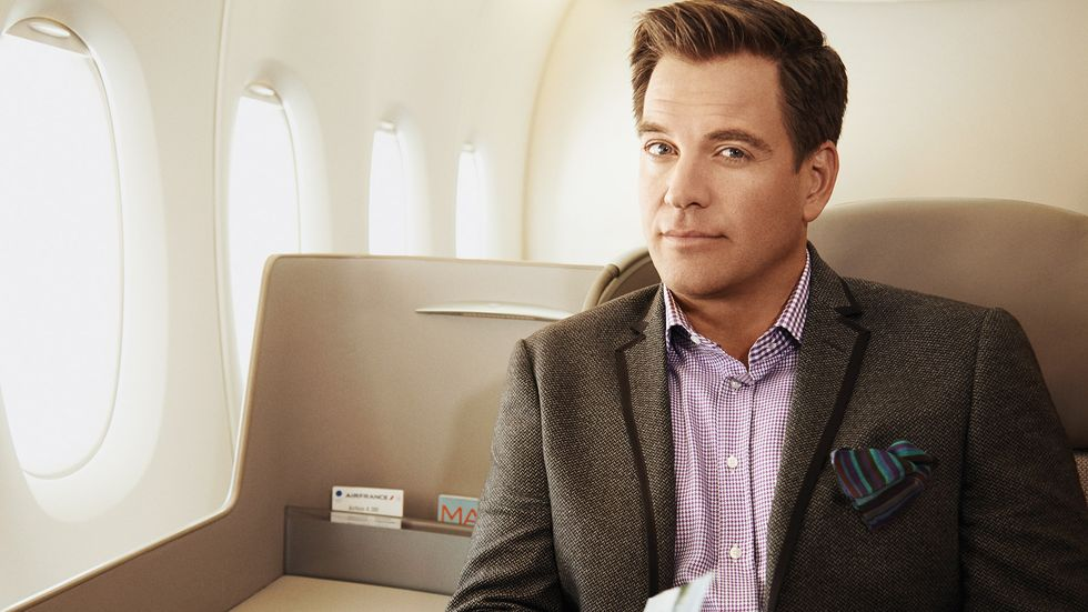 Michael Weatherly in suit on airplane