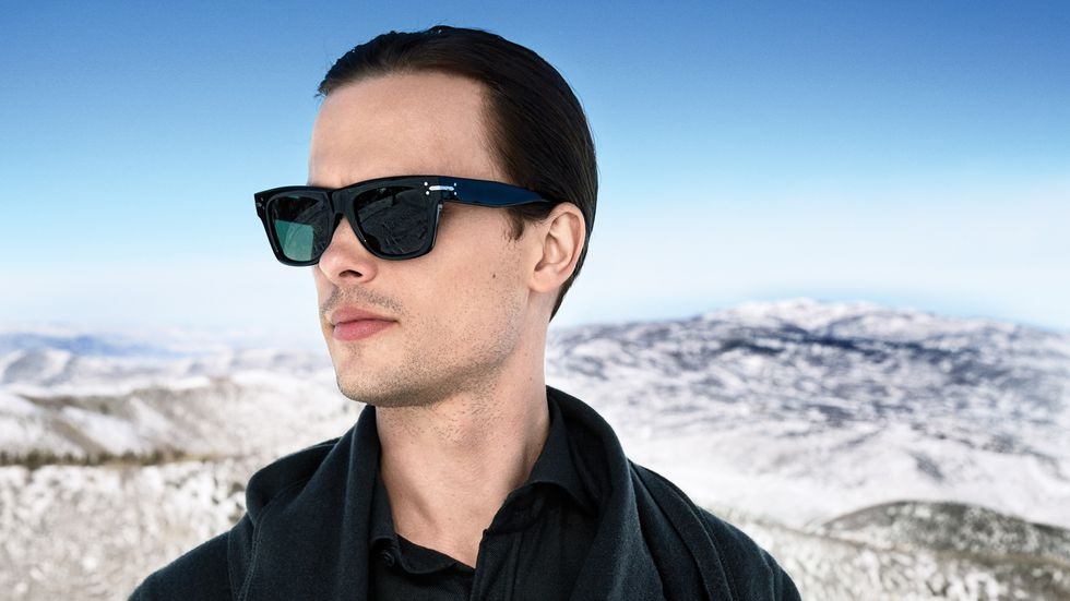 Matthew Gray Gubler in black sunglasses with snow capped mountains