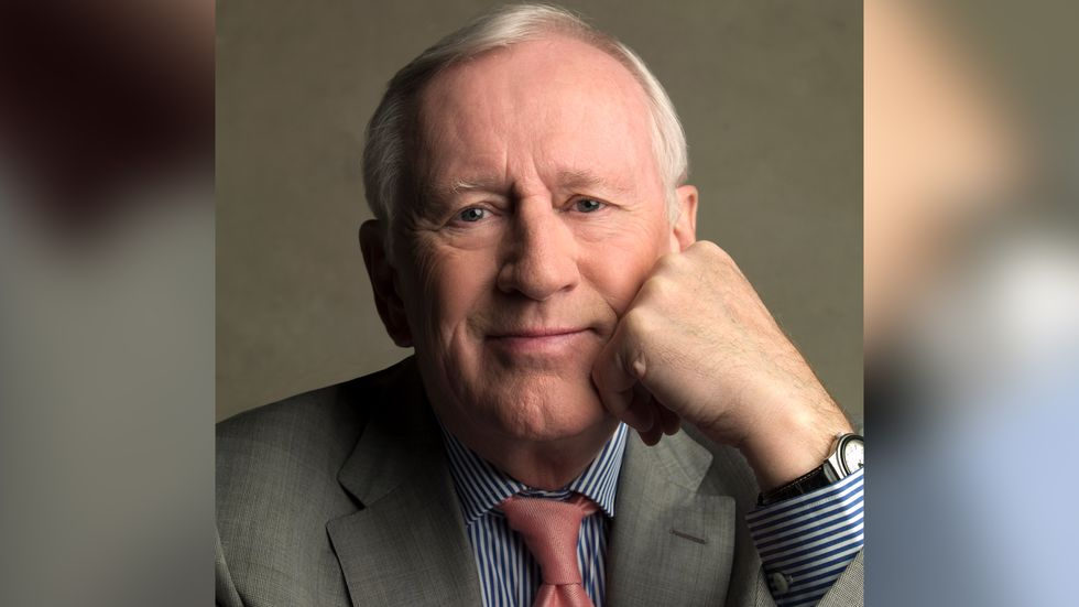 Len Cariou close up in grey suit