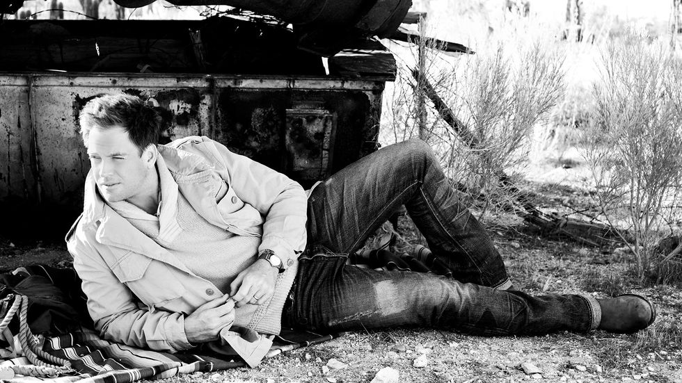 Michael Weatherly laying down in denim