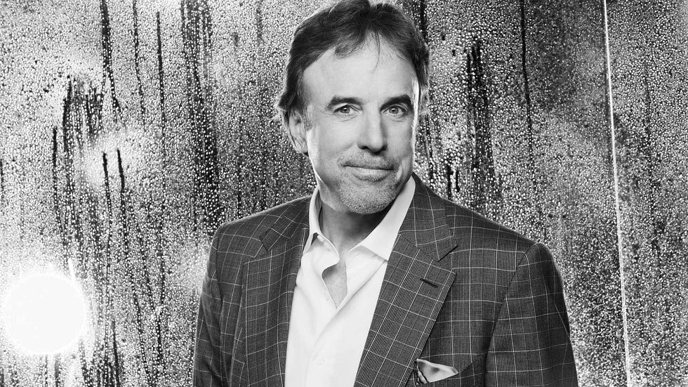 Kevin Nealon in checkered suit