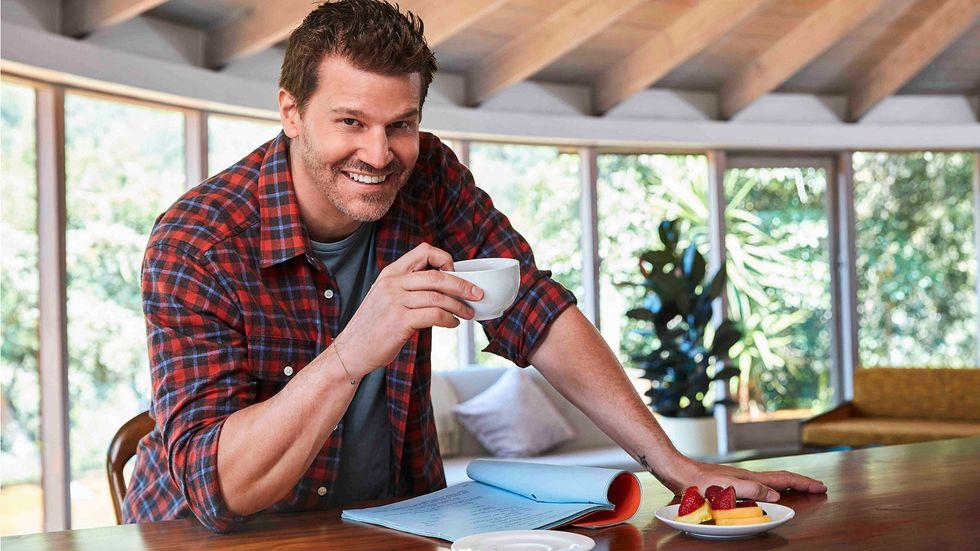 David Boreanaz drinking coffee in plaid shirt