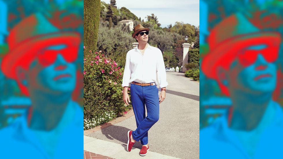Michael Weatherly looking chic in blue pants and white top