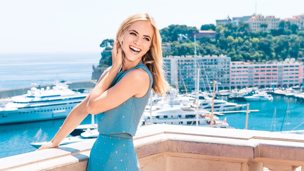 Emily Wickersham dressed in blue over looking marina