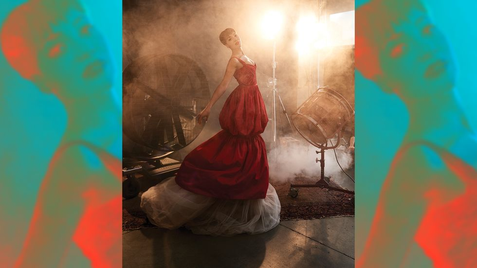 Cush Jumbo holding dramatic pose in red gown