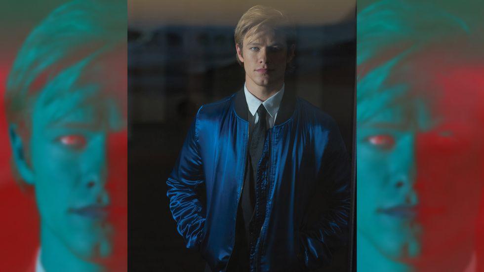 Lucas Till in royal blue jacket