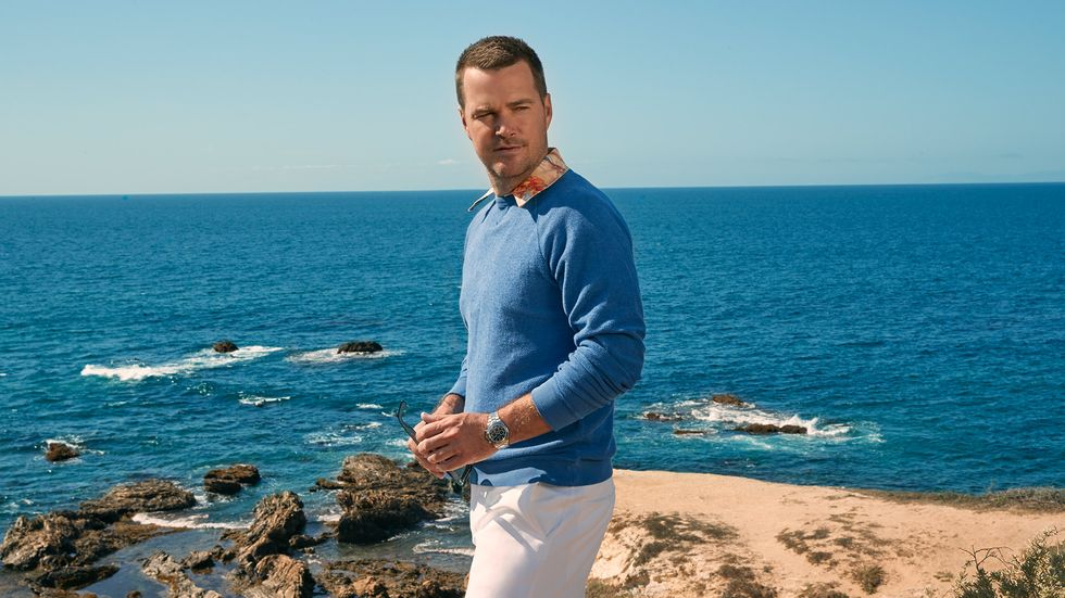 Chris ODonnell in blue sweater overlooking the ocean