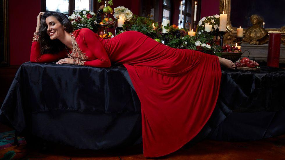Daniela Ruah of NCIS Los Angeles posing on banquet table