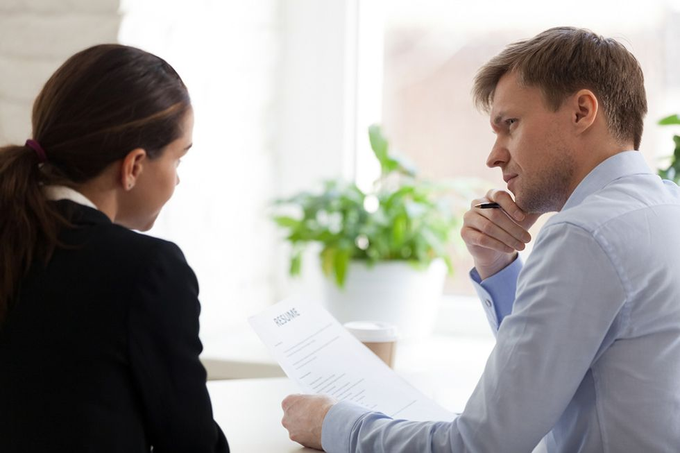 An interviewer holds a resume with an objective statement