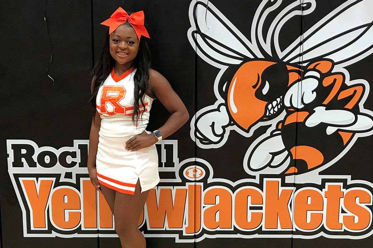 A high school cheerleader jumped off her parade float to save a choking toddler's life