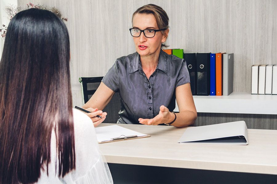 Manager goes over her employee's career objectives.