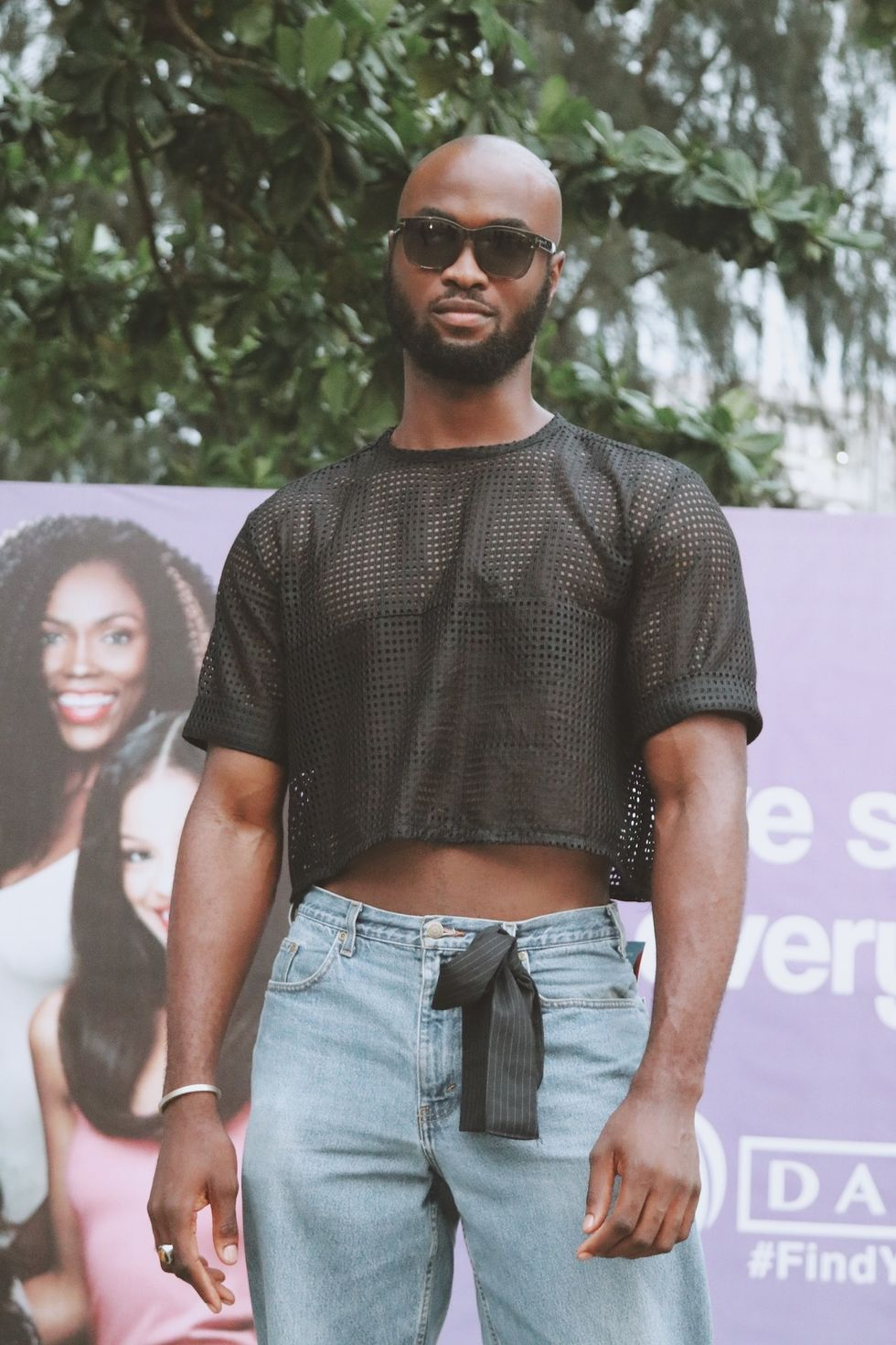 Nigerian man wearing mesh shirt during Lagos Fashion Week 2019