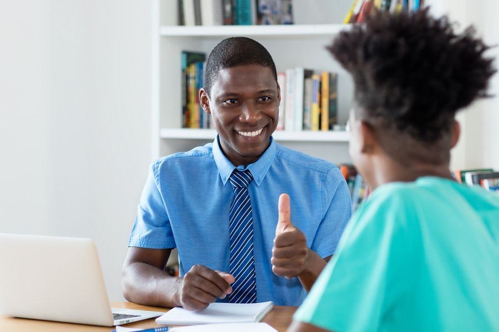 A teacher successfully answers hard job interview questions