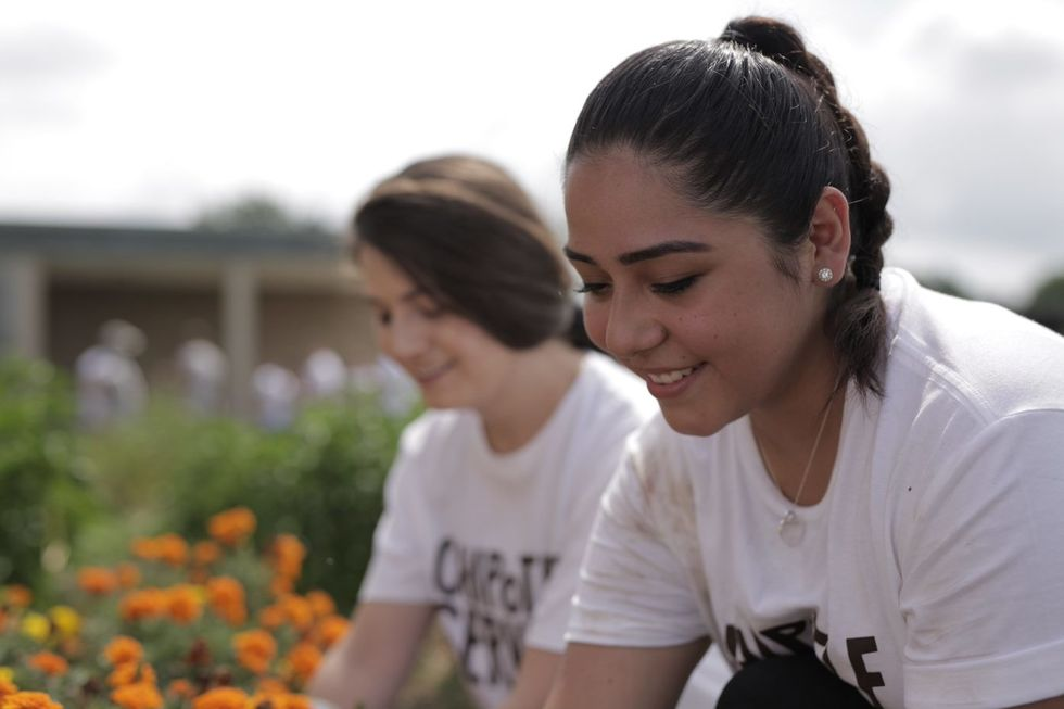 Chipotle employees work at a recent community service project.