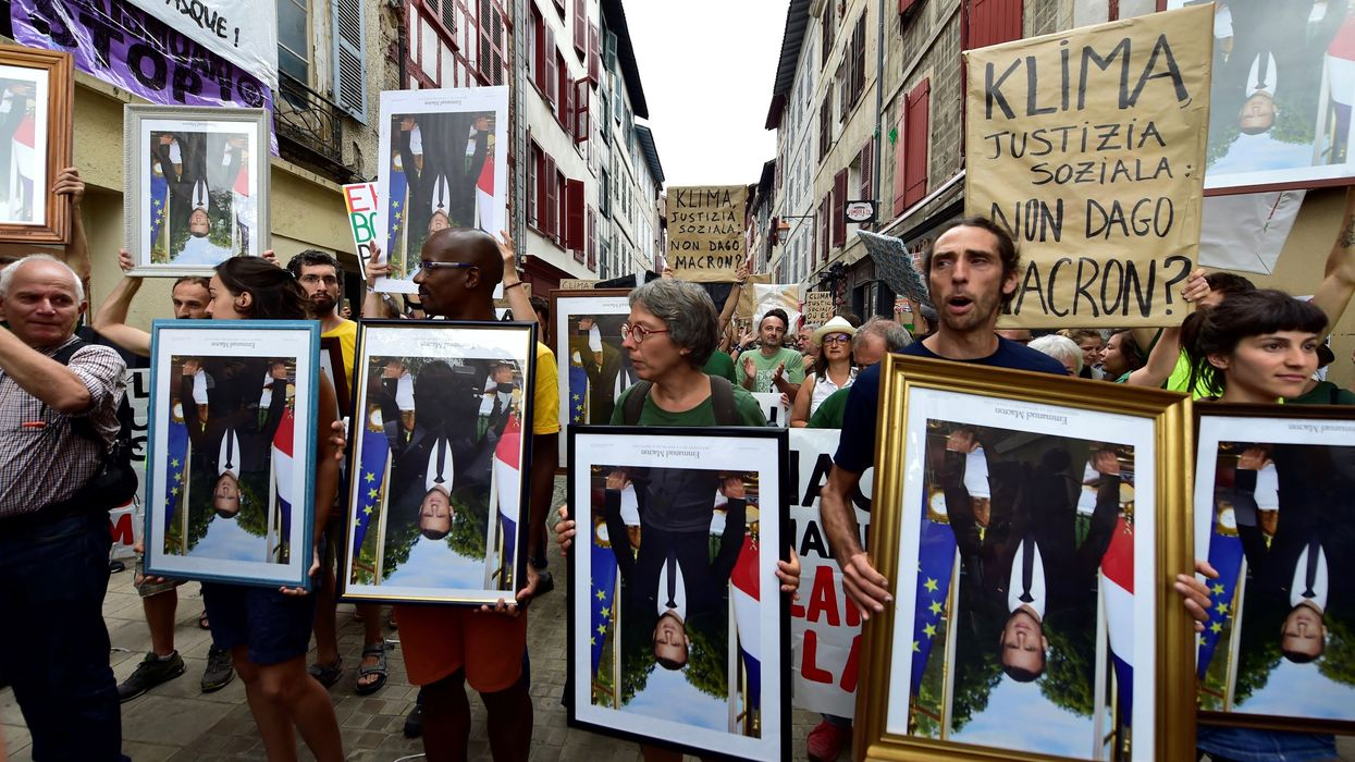 French Activists Face Charges for Stealing Portraits of Macron