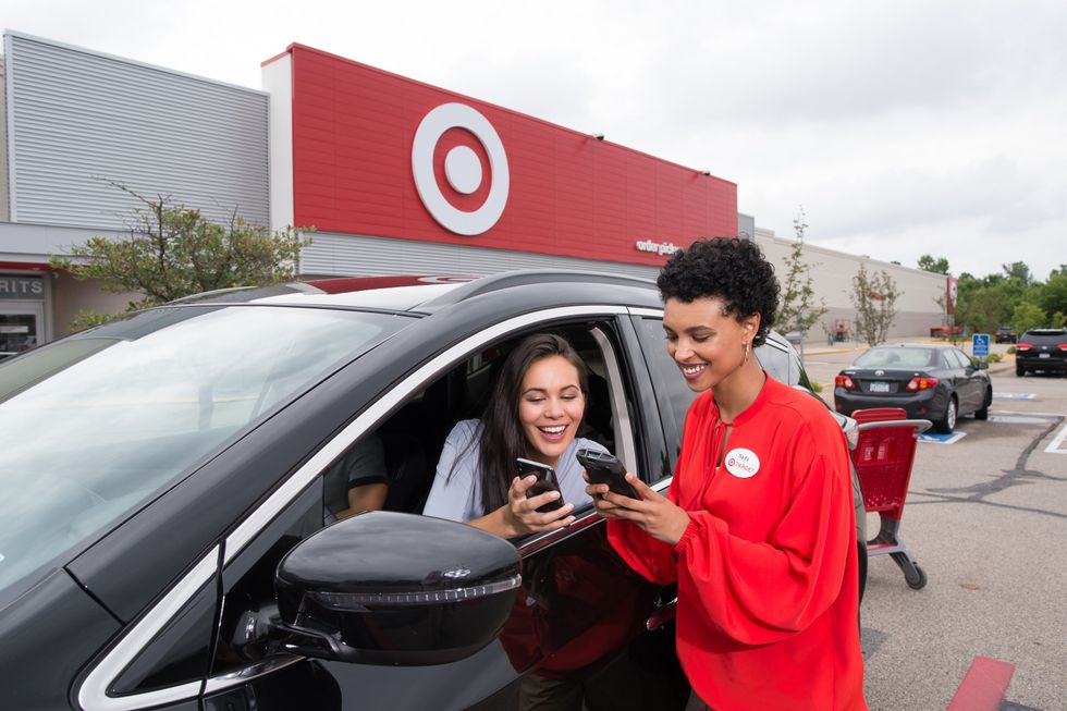 A Target employee helps a customer at the Drive-Up.