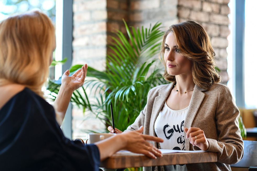 Recently laid off women networking at a local cafe