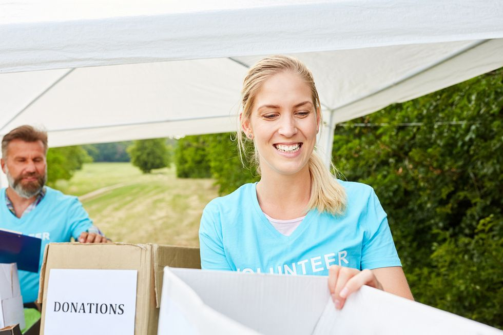 Young unemployed woman volunteering at a donation drive to fill time while she looks for a job.