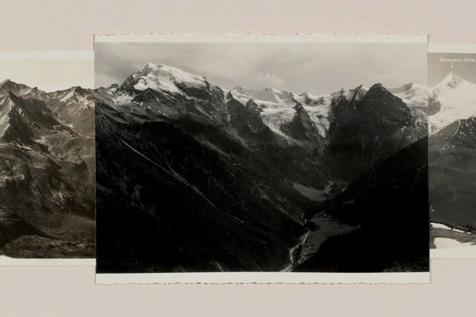 This black and white image shows a mountain range.