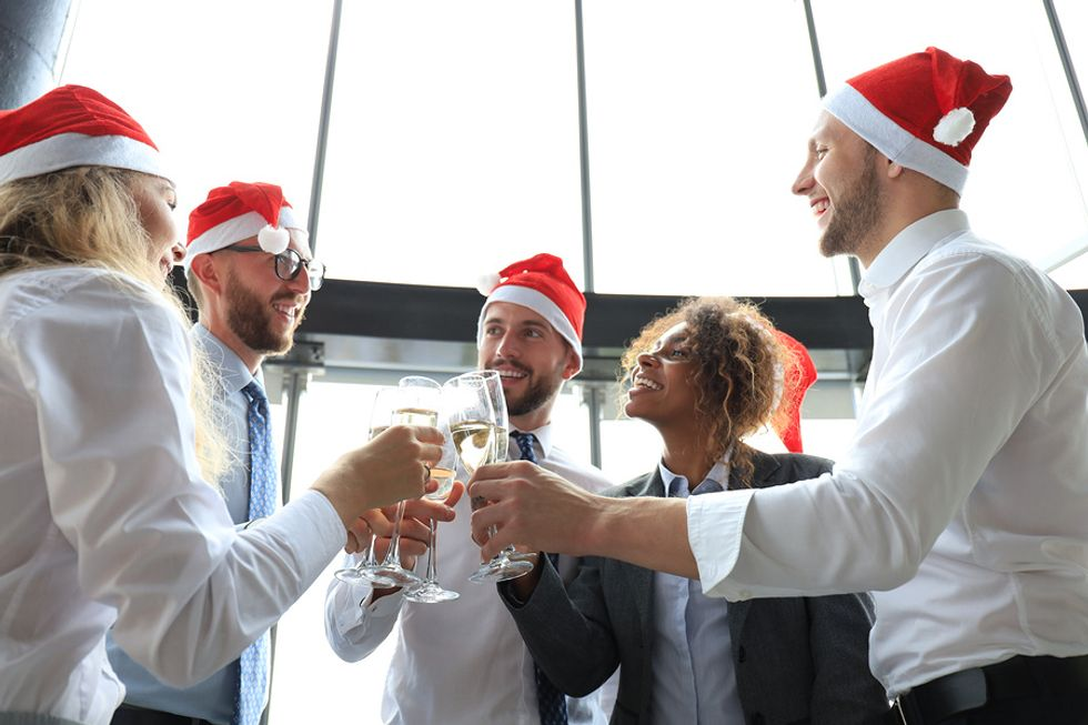 Employees networking at the office holiday party