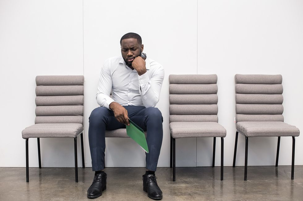 Man waiting for an interview for a job with less competition during the holiday season
