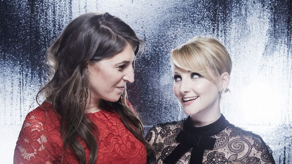 Mayim Bialik and Melissa Rauch smiling at each other