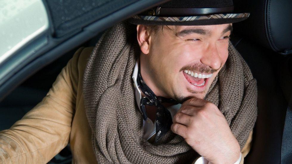 Johnny Galecki laughing wearing scarf