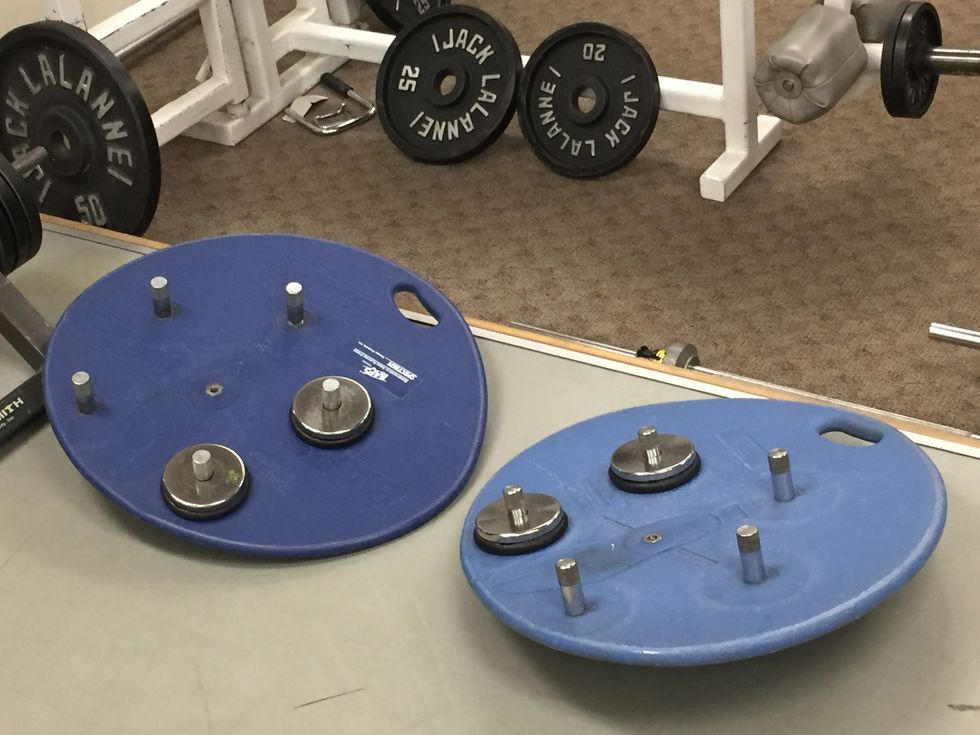 Blue circular boards with metal pieces sticking out of them.
