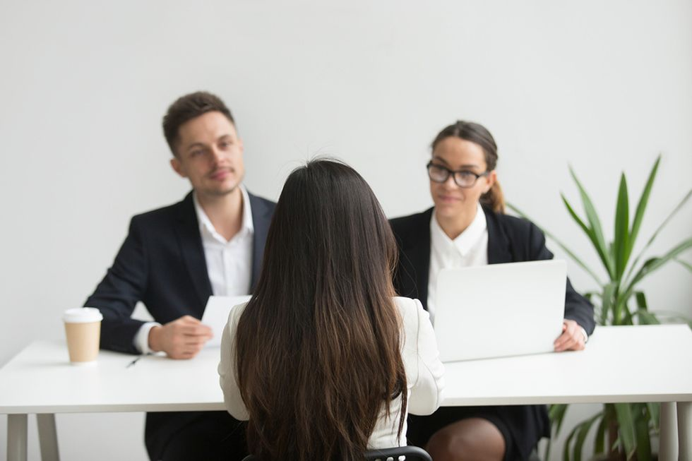 Hiring managers judging potential job candidate on her appearance in an interview