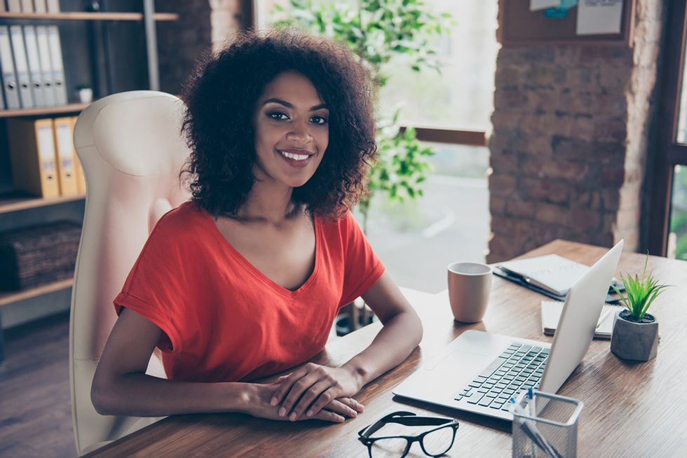 Successful businesswoman is happy working her dream job every day.