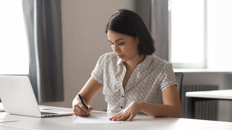 Job seeker writing an outstanding personal branding statement