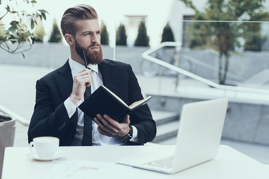 Professional man thinking about his career goals to write a powerful personal branding statement