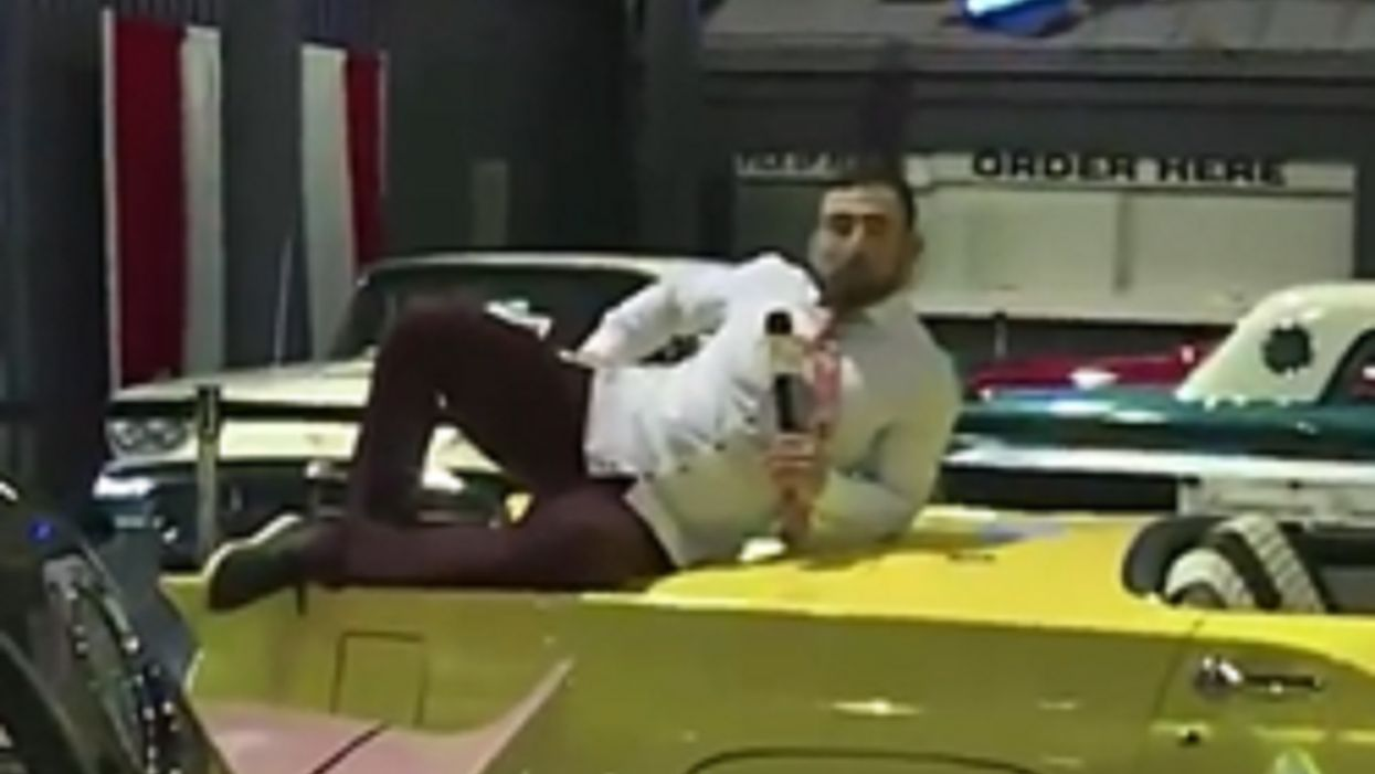 TV reporter canned after climbing on a classic car — and dooring another — during live broadcast