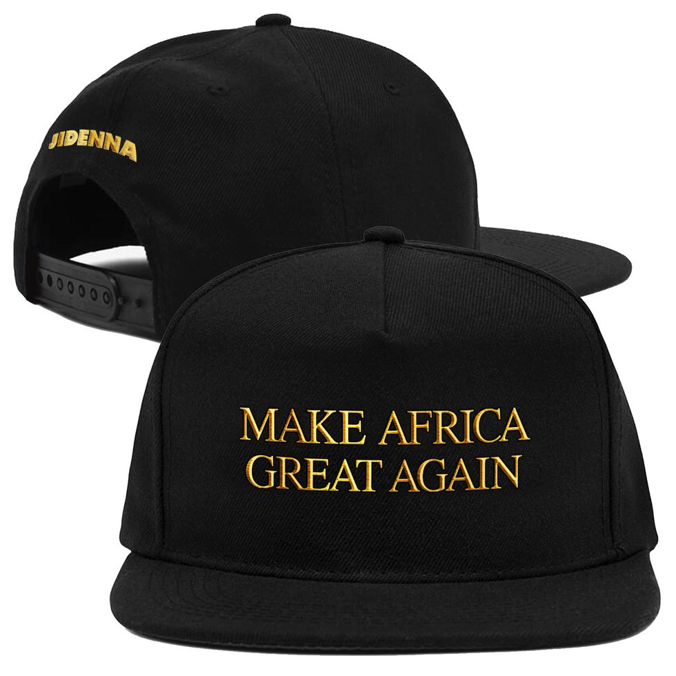 The Make Africa Great Again snapback hat in black with gold writing in the style of one of Trump's MAGA hats.