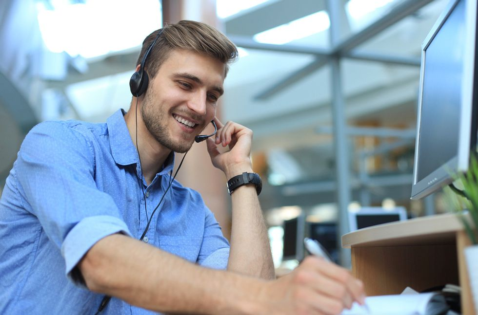 Professional man using tips to be happier at work