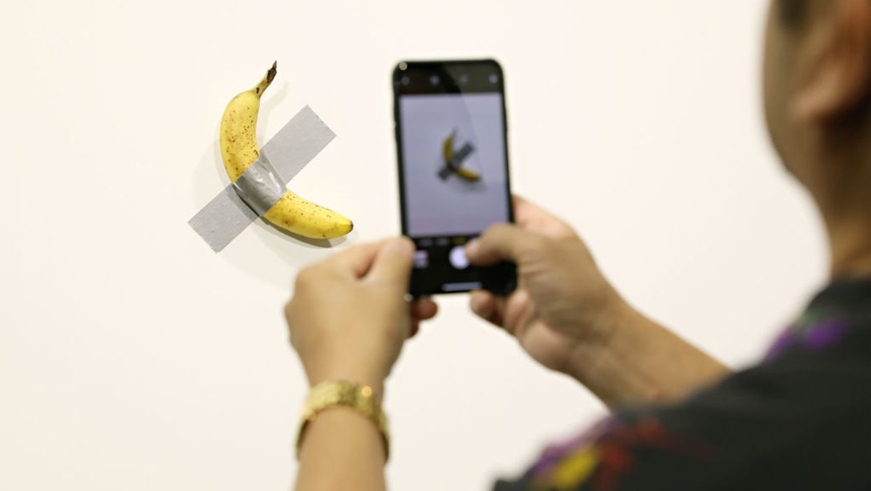 Video: Man eats $120,000 banana 'art work' that was duct-taped to a wall