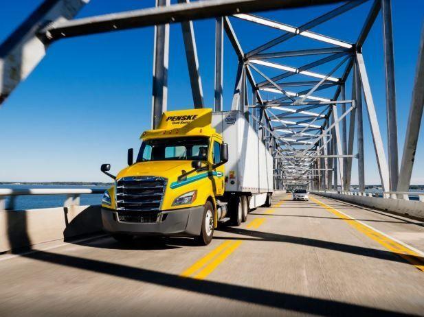 Penske tractor driving over bridge
